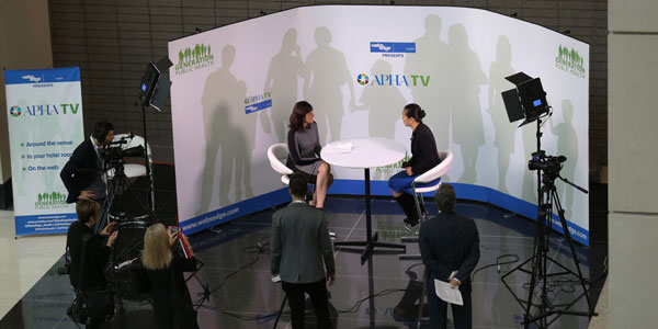 two women at table while being filmed for APHA TV