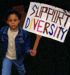 boy holds protest sign