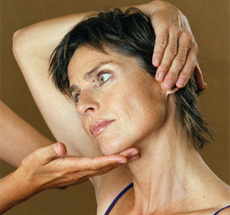 Woman getting neck adjusted by chiropractor