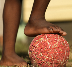 Bare foot on rubber band ball