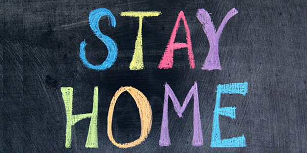 STAY HOME written on chalkboard