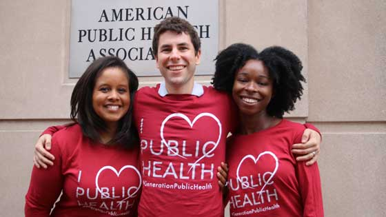 three APHA staffers in I love public health T shirts