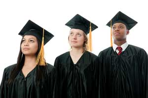 three students in caps and gowns